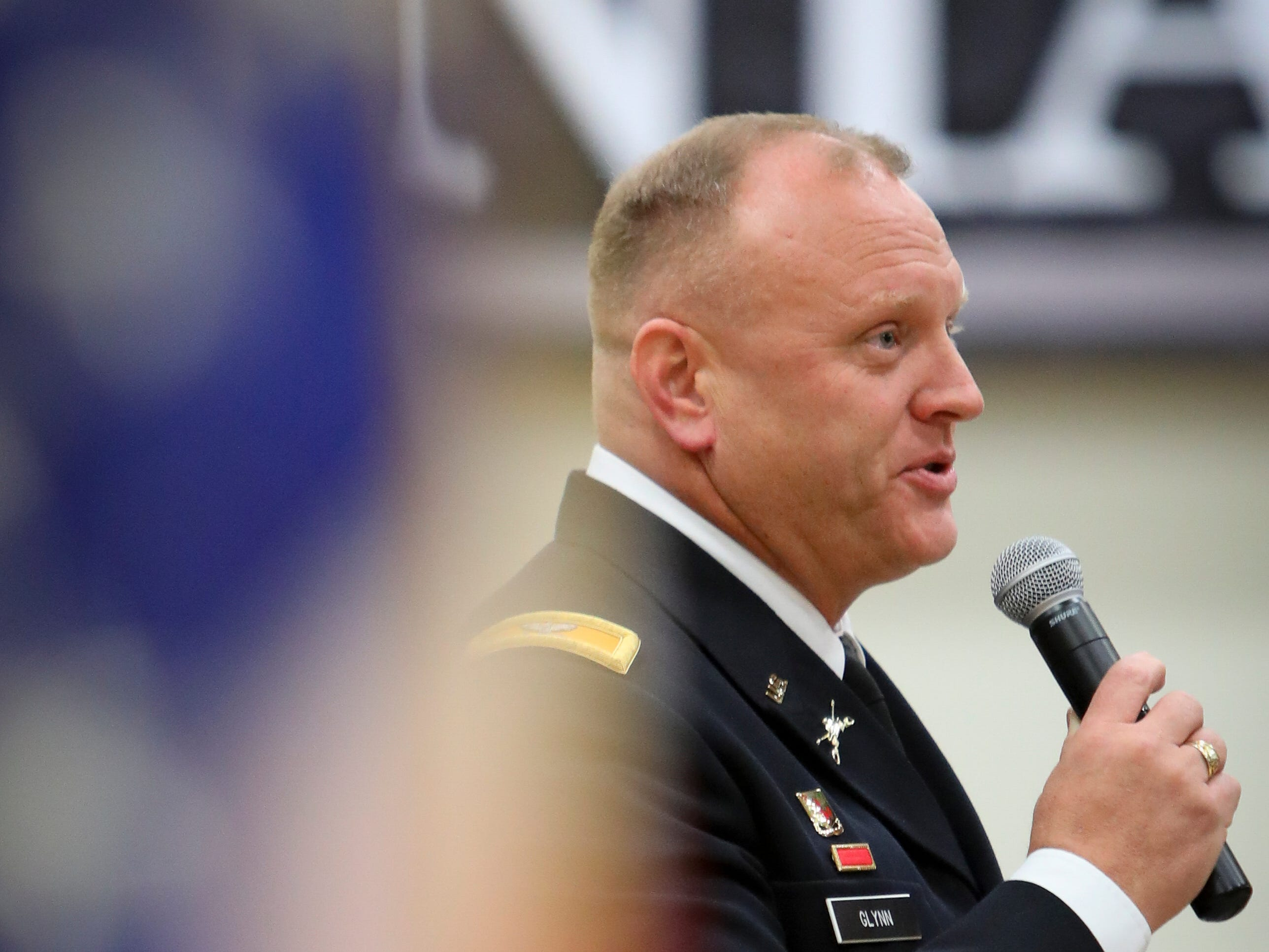 Colonel Tim Glynn, from the Army, gives a speech during a Veterans Day Breakfast at Northview Middle School on Wednesday, Nov. 14, 2018 in Ankeny, Iowa. Middle school students hosted the veterans to share their gratitude before an assembly.