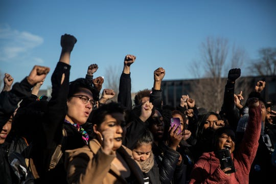 Drake University students and faculty gather at the Helmick Commons for a rally to encourage unity after racist robocalls and notes were left on campus, on Wednesday, Nov. 14, 2018, in Des Moines.
