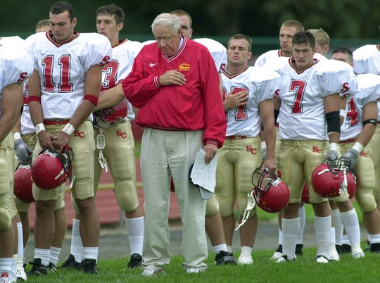 From 2001: Simpson College football coach Jim Williams and his players are shown during a moment of silence before a game Sept. 15, 2001 against Buena Vista, just days after the attacks of 9/11.