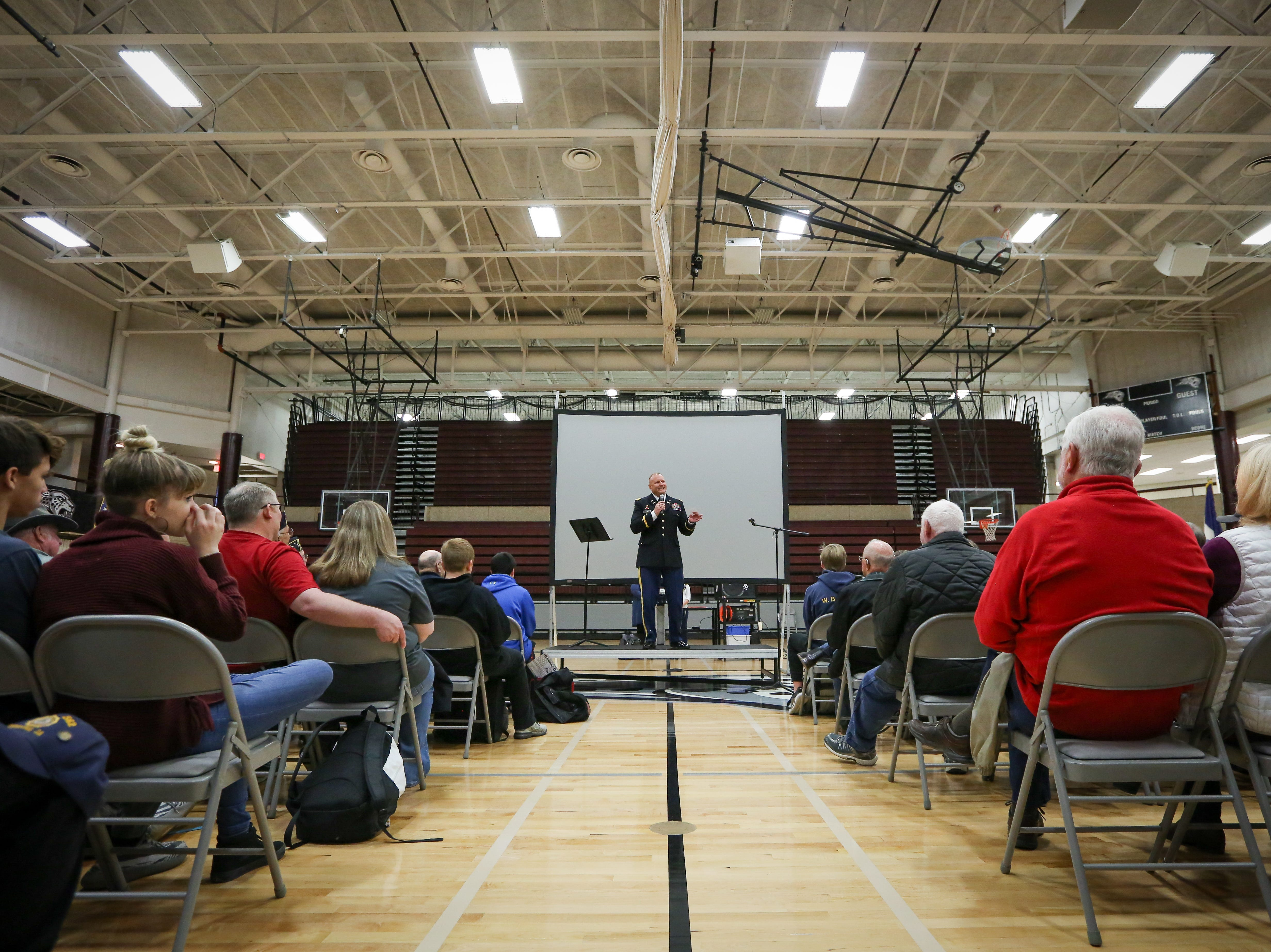 Colonel Tim Glynn, from the Army, gives a speech during Veterans Day Breakfast at Northview Middle School on Wednesday, Nov. 14, 2018 in Ankeny, Iowa.