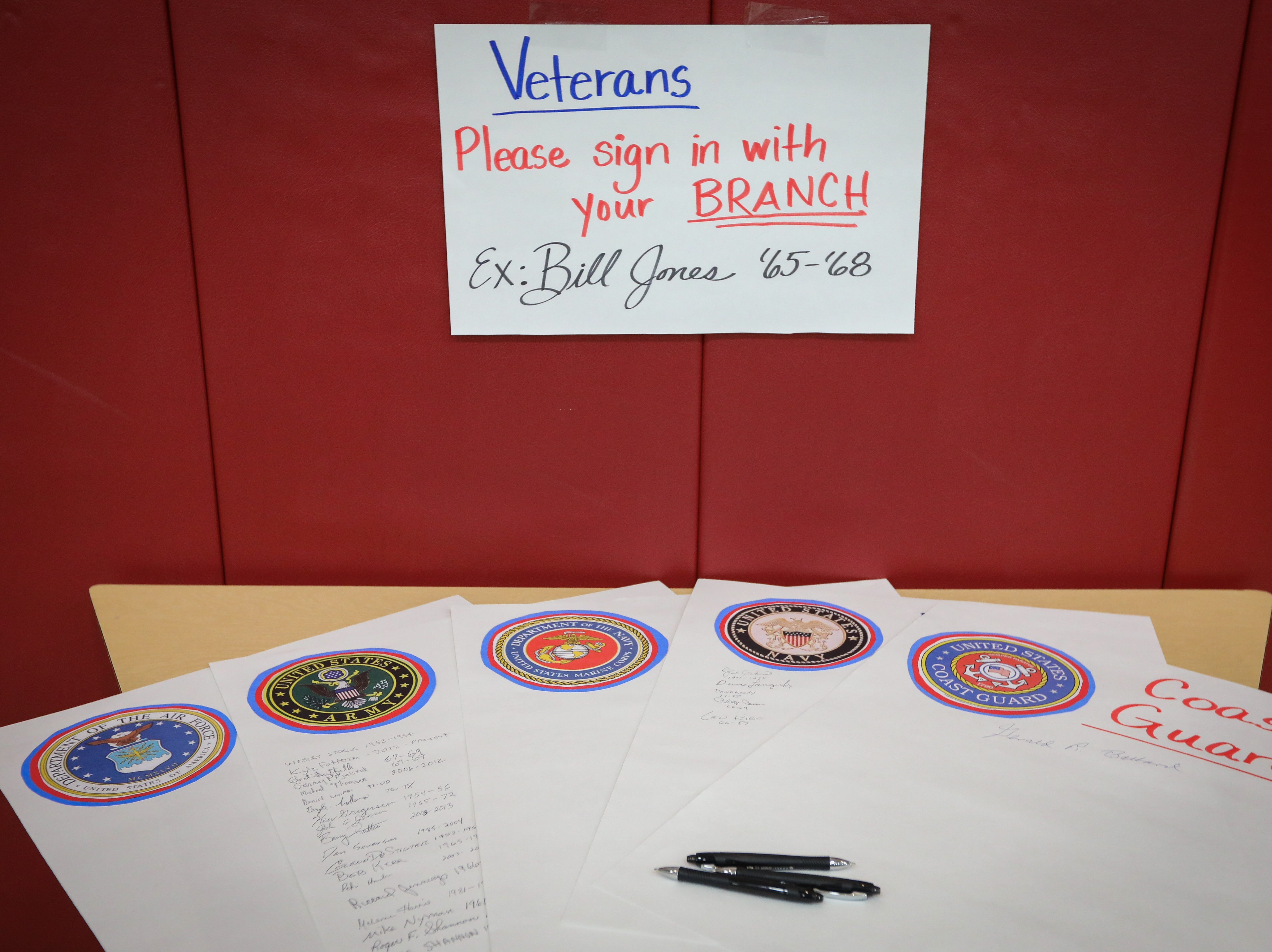 Veteran sign-in sheets are posted as attendees from the five branches of the United States Armed Forces file into a Veterans Day Breakfast at Northview Middle School on Wednesday, Nov. 14, 2018 in Ankeny, Iowa. Middle school students hosted the veterans to share their gratitude before an assembly.