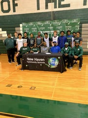 New Haven star Romeo Weems signs his nation letter of intent with DePaul with friends, family, teammates and coaches on hand.