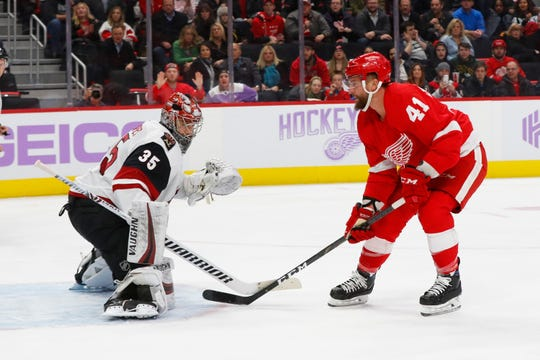Detroit Red Wings center Luke Glendening (41) scores on Arizona Coyotes goaltender Darcy Kuemper (35) in the second period of an NHL hockey game, Tuesday, Nov. 13, 2018, in Detroit.
