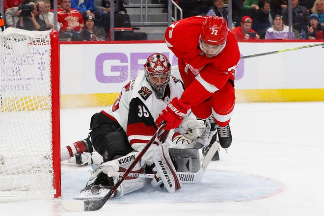 Arizona Coyotes goaltender Darcy Kuemper stops a shot from Detroit Red Wings center Andreas Athanasiou in the second period Nov. 13, 2018, in Detroit.