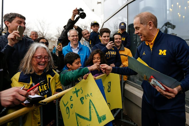 Michigan head coach John Beilein signs autographs for fans during the Final Four send off outside of Crisler Center in Ann Arbor, Wednesday, March 28, 2018.