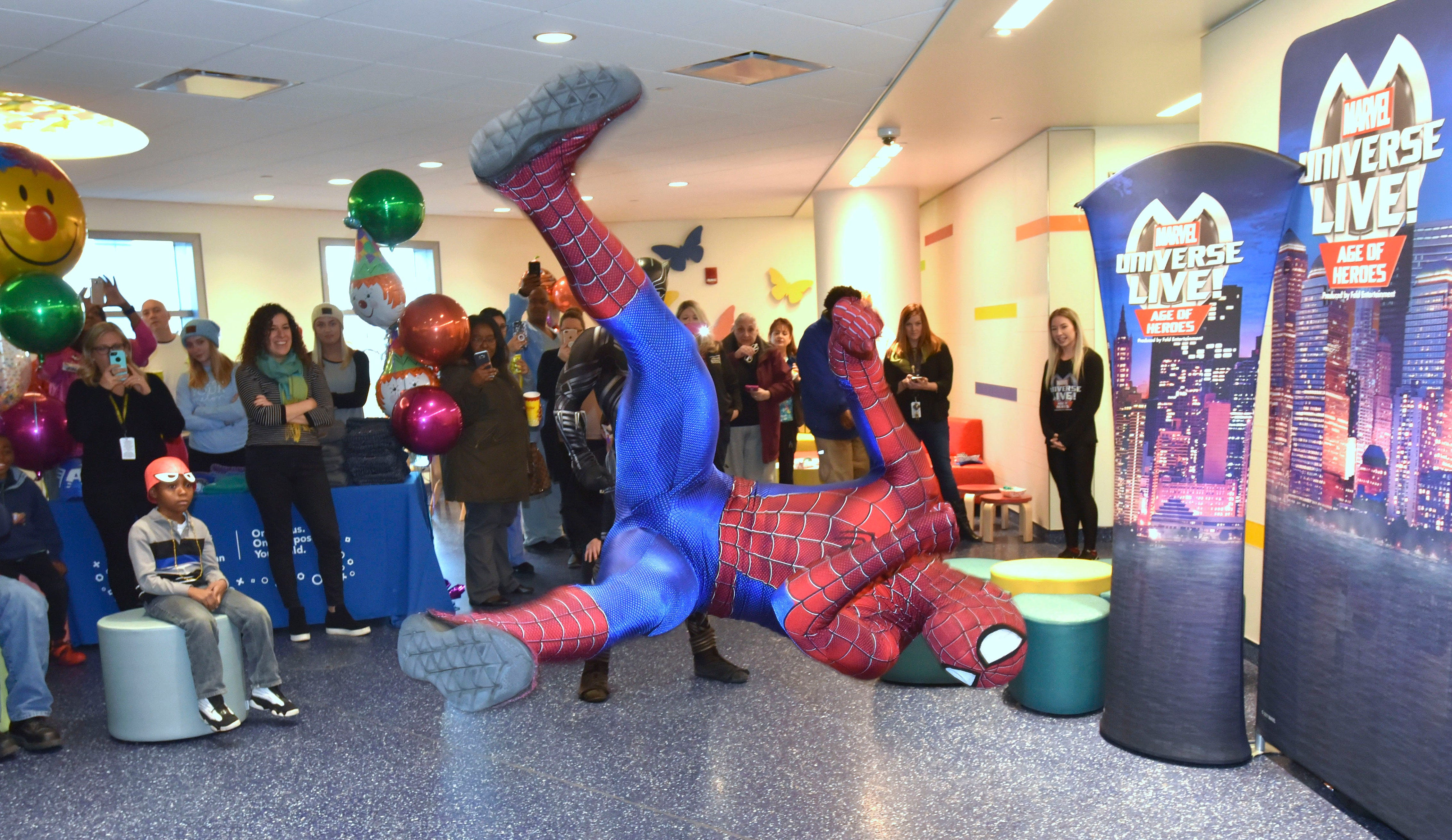 Marvel Universe Live performer Jaden Ponce, of Wisconsin, does a flip as he portrays Spider-Man in front of kids at Children's Hospital of Michigan.