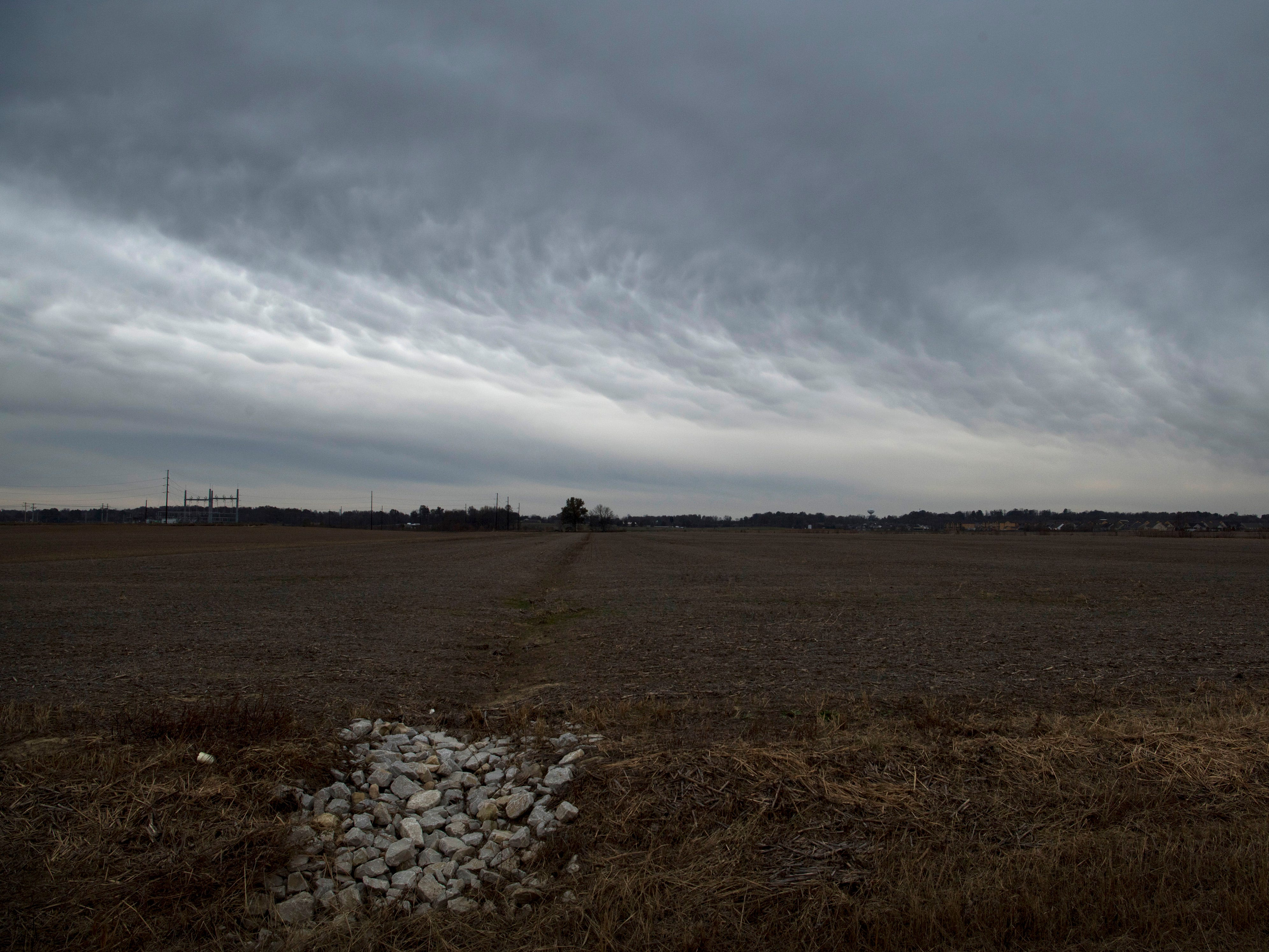 Storm clouds move north above Warrick County at 1:36 p.m. Wednesday. The area is expecting a winter storm to hit Evansville at 2:30 p.m. and leaving freezing rain and 2-5 inches of snow.