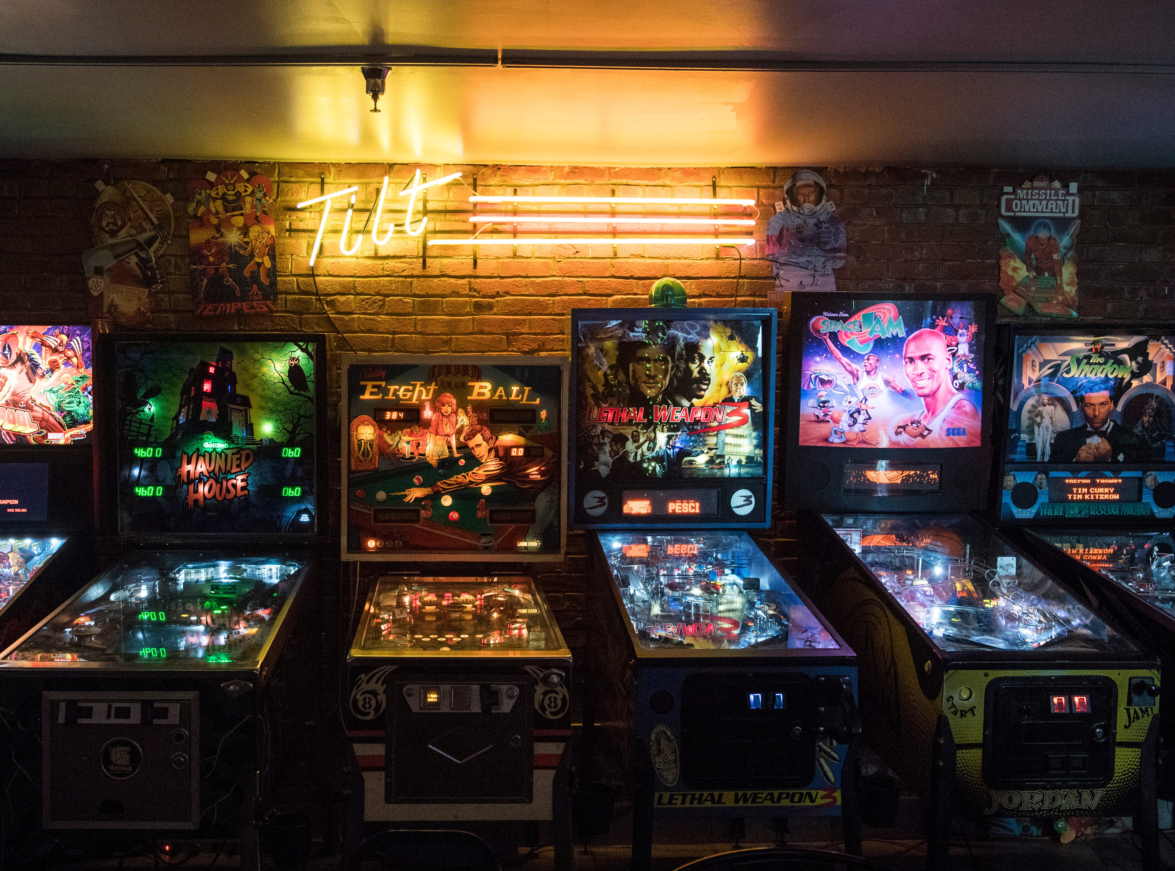 Pinball machines line the back wall of High Score Saloon.