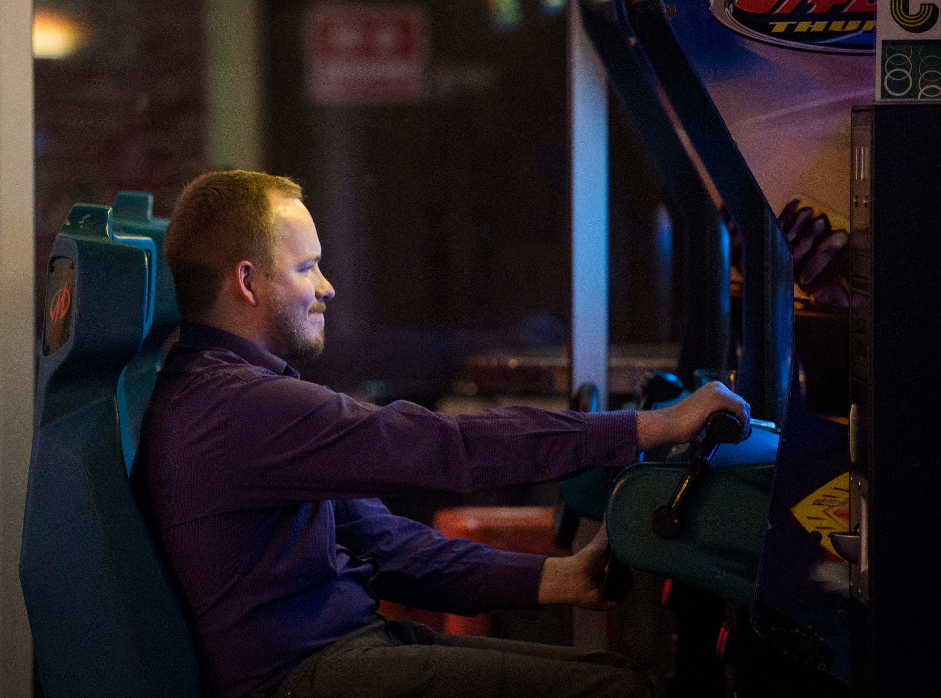A customer plays the boat racing game Hydro Thunder at High Score Saloon Wednesday Oct. 10, 2018.