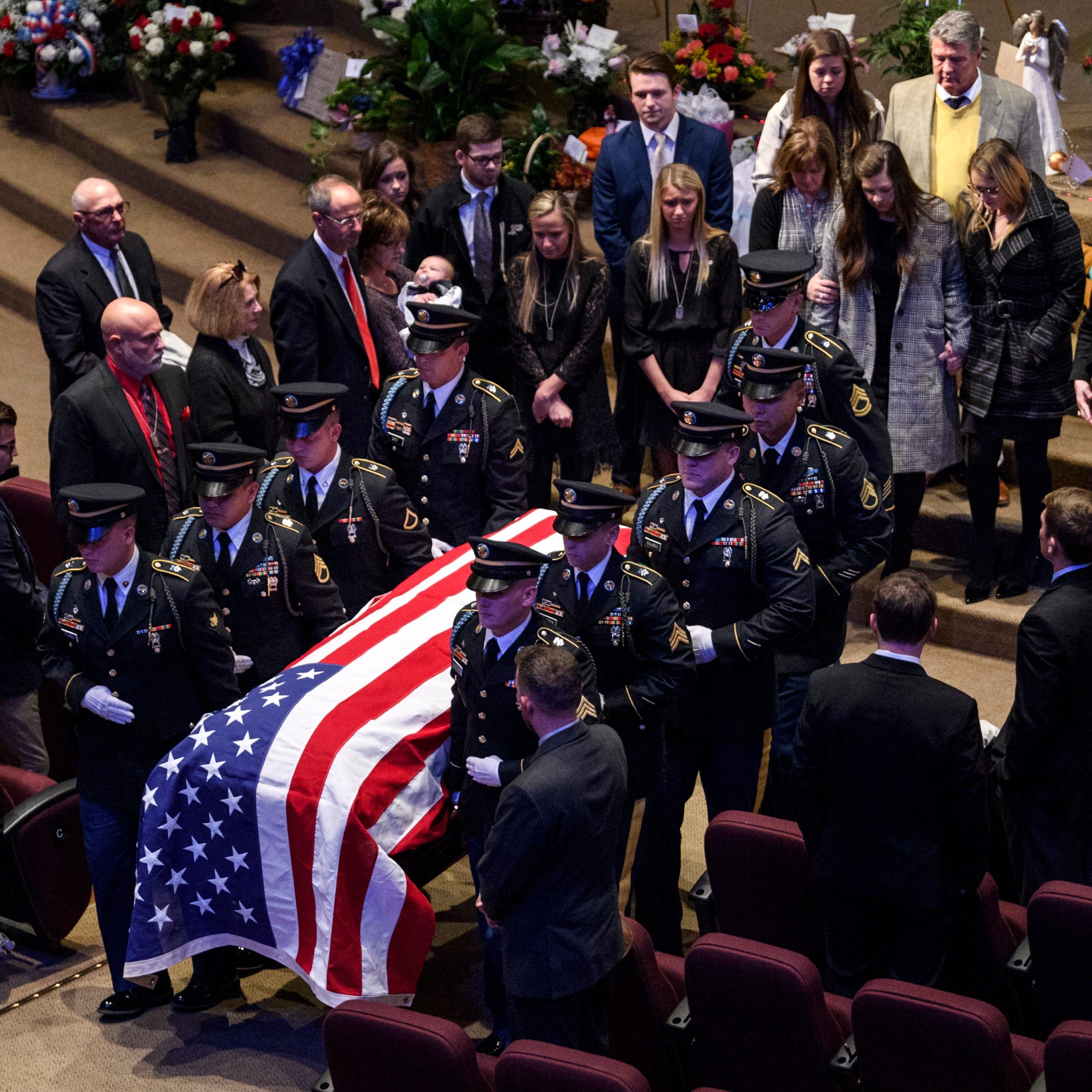 """Army Sgt. Drew Watters' casket is carried out of the chapel as his family follows close behind at Christian Fellowship Church during a """"Celebration of Life"""" ceremony in Evansville, Ind., Wednesday afternoon, Nov. 14, 2018. The 23-year-old Evansville native died in a military training accident at Joint Base Lewis-McChord, Sunday, November 4."""