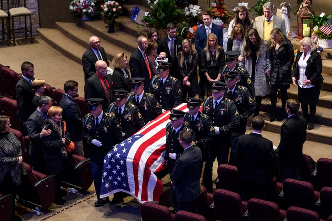 "Army Sgt. Drew Watters' casket is carried out of the chapel as his family follows close behind at Christian Fellowship Church during a ""Celebration of Life"" ceremony in Evansville, Ind., Wednesday afternoon, Nov. 14, 2018. The 23-year-old Evansville native died in a military training accident at Joint Base Lewis-McChord, Sunday, November 4."