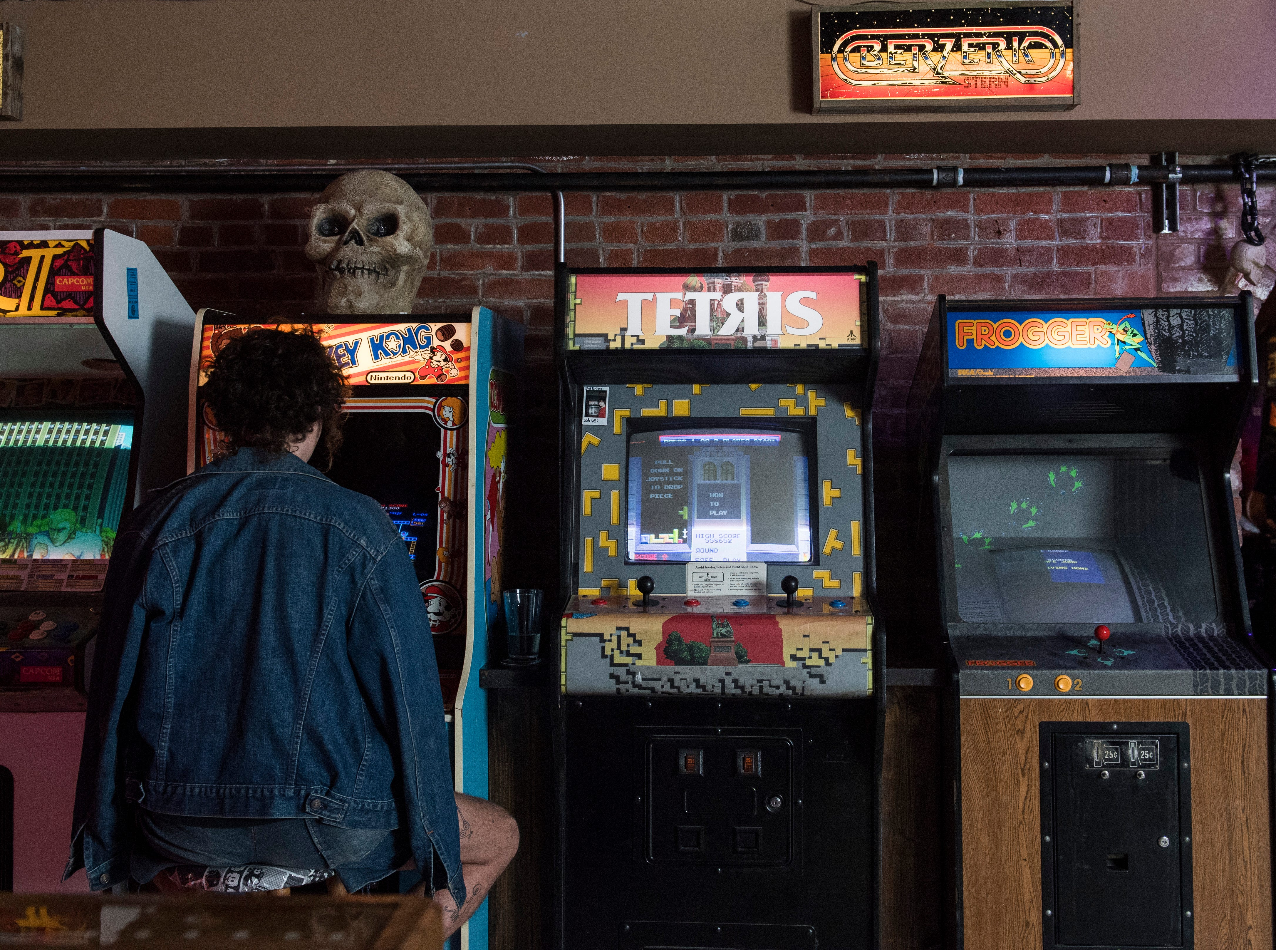 A customers plays Donkey Kong at High Score Saloon on Wednesday Oct. 10, 2018.