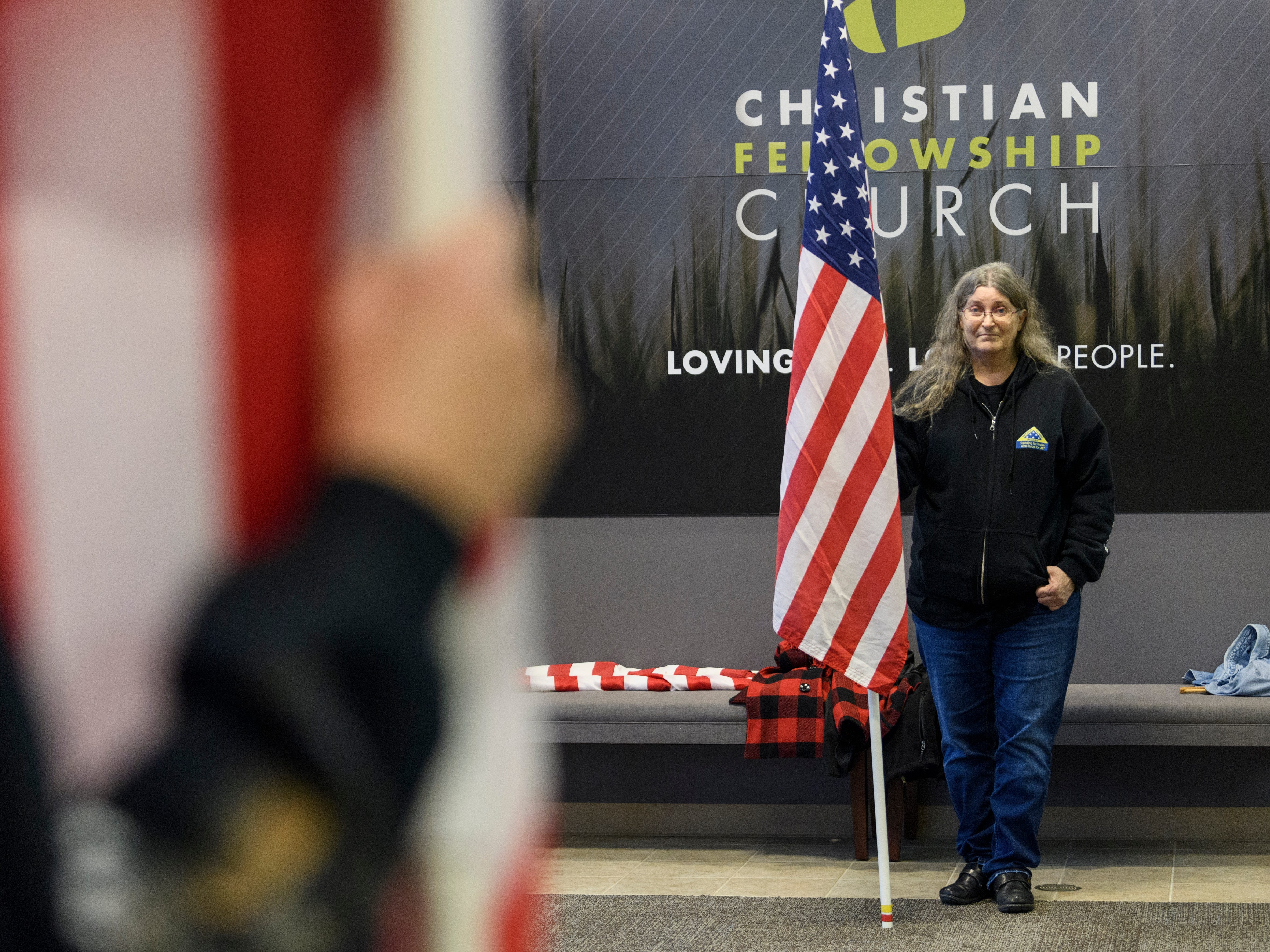 Julie Davidson, right, stands across from Peggy Jo Hammond, left, as they display American Flags in the entryway of Evansville's Christian Fellowship Church during a visitation held for Army Sgt. Drew Watters, Tuesday afternoon, Nov. 13, 2018. The group, which includes military veterans and civilians, attend memorial services at the request of deceased soldiers' or veterans' family.