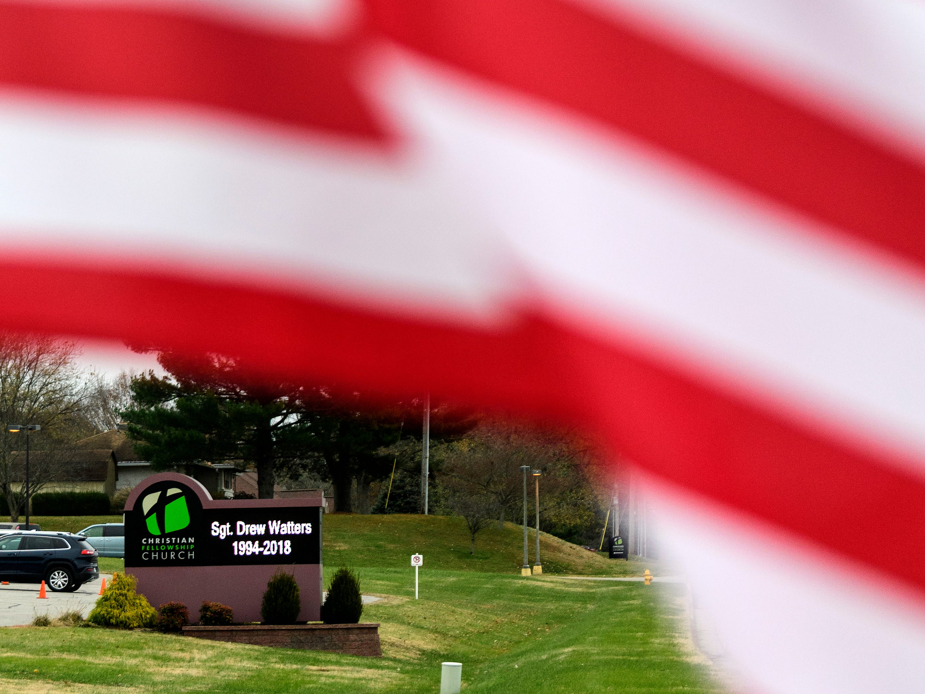 People attend the visitation for Army Spc. Drew Watters at Christian Fellowship Church in Evansville, Ind., Tuesday, Nov. 13, 2018.
