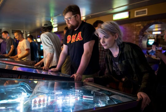 Customers fill the room during pinball league night Wednesday Oct. 10, 2018.
