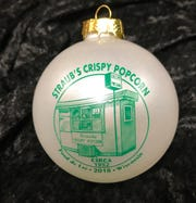 This year's Soroptimist Ornament features Straub's Crispy Popcorn Stand.