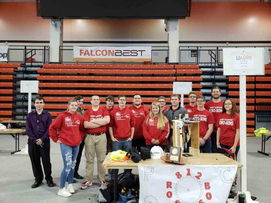 Port Clinton High School Robotics Team, the Robo-Skins, at the Bowling Green State University Falcon BEST Robotics competition are, from left, Chase Barton, Madyson Webb, Ben Lucas, William Zimmerman, Dylan Smothers, Willy Brooks, Gabe Armendariz, Ally Batterton, Richard McLaughlin Jr., Leo Winterich, Nathan Nellett, Tommy Brooks, Mr. Bobby Good, Adviser, and Gabie Klein (pep band).