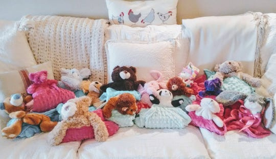 Stuffed animals left in front of the Watts' home in Frederick will be turned into blankets and donated to local police departments.