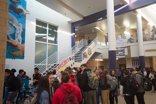 Fort Collins High School students wait for class to start on a late arrival day on Nov. 14, 2018. The Poudre School District Board of Education has decided to move high school start to 9 a.m. beginning in the 2019-20 academic year.