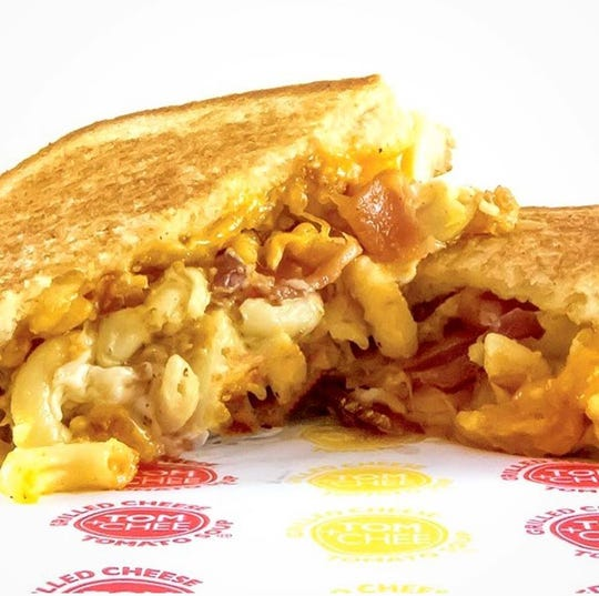 A macaroni and grilled cheese sandwich from Tom & Chee.