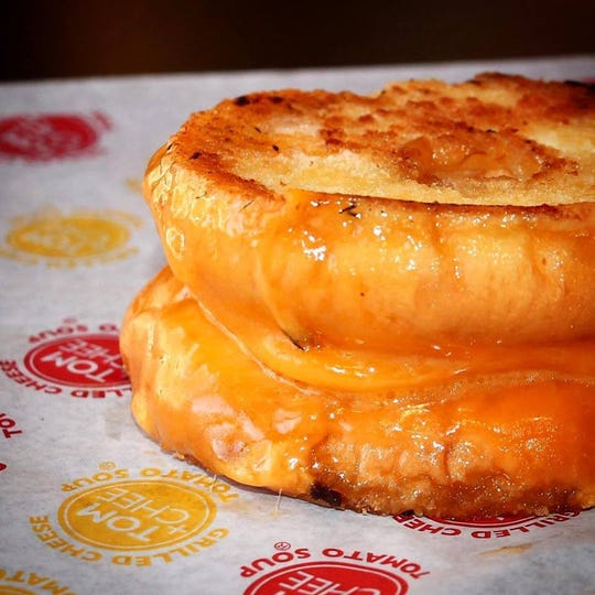 A grilled cheese doughnut from Tom & Chee.