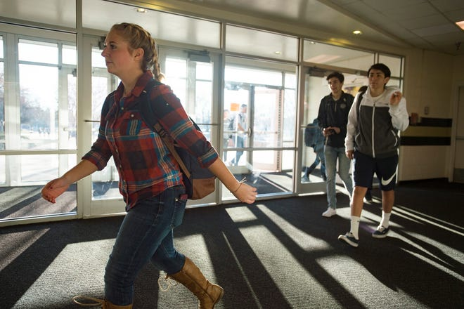 Fort Collins High School students walk into school on a late arrival day on Wednesday, Nov. 14, 2018.