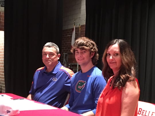 LaBelle High School senior pitcher Tyler Nesbitt signed to play baseball at the University of Florida on Wednesday in a ceremony at the school auditorium.
