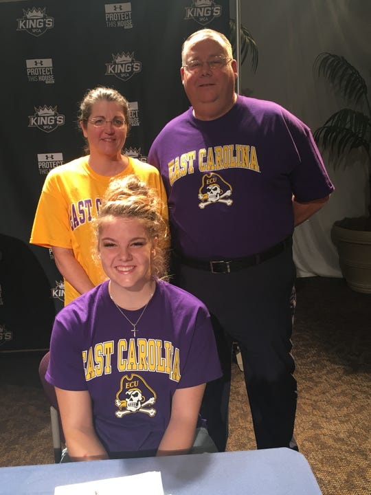 SFCA track and field standout Rebekah Bergquist signs her National Letter of Intent to compete at East Carolina in a ceremony on Nov. 14.