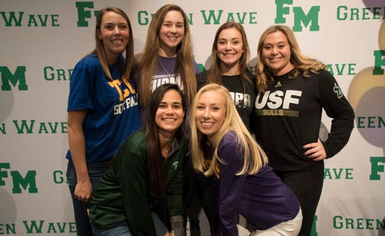 Six Fort Myers High School softball players signed letters of intent with colleges on Wednesday. From left, Maddy Walther-Tallahassee CC; Tampa; Riley Ludlam- Furman; Maria Angelino –Dartmouth; Meghan Kline- Lipscomb; Avery Perkins- Tampa and Vivian Ponn-USF.