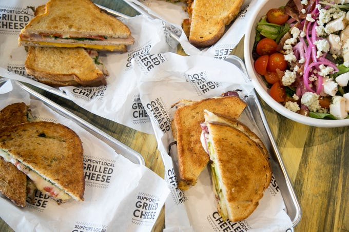 The American Grilled Cheese Kitchen has a variety of different grilled cheese sandwiches as well as salads, soups and sides. They also serve breakfast.