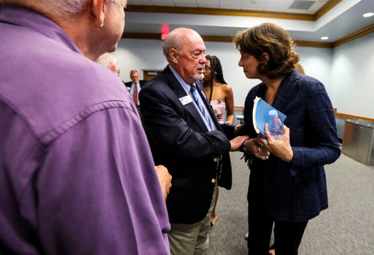 FGCU president Michael Martin visits with NPR journalist Mara Liasson during First Amendment Festival.