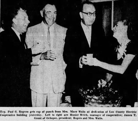 Rep. Paul G. Rogers gets cup of punch from Mrs. Mary Wallo at dedication  of Lee County Electric Cooperative building yesterday. Left to right are Homer Walch, manager of cooperative, James T. Gaunt of Ochopee, president: Rogers and Mrs. Wallo.