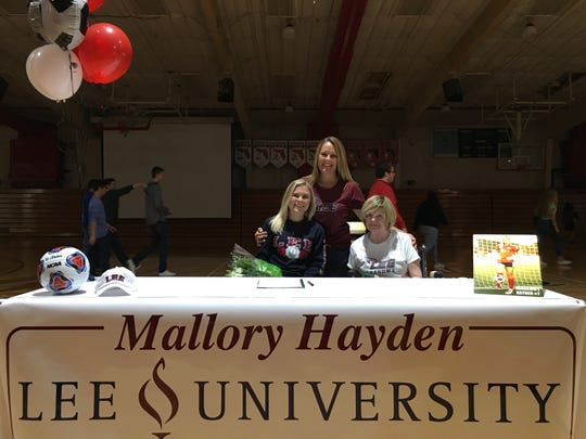 Mallory Hayden is joined by her mother, Mellanie, and grandmother, Stephanie Blair, after signing with Lee University on Wednesday, Nov. 14, 2018, at Evangelical Christian School in Fort Myers.