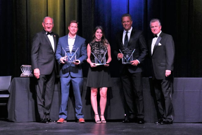Al Zichella, past president of FHBA and Chuck Fowke, third vice chairman of the NAHB present Dan Adams of Stevens Construction and Lerin Byrd of GCG Construction, who tied, with the Summit Grand Award for Commercial Contractor of the Year and George Mato of Miromar Development with the Pinnacle Grand Award for Residential Developer of the Year.