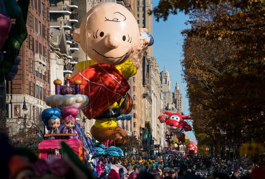 A Charlie Brown balloon moves along Central Park West during the Macy's Thanksgiving Day Parade in New York, Thursday, Nov. 23, 2017. (AP Photo/Craig Ruttle)