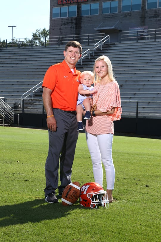 Harry Cabaniss, in his second season as Mauldin High School's football coach, and his wife, Haley, juggle their careers and 16-month-old son Will.