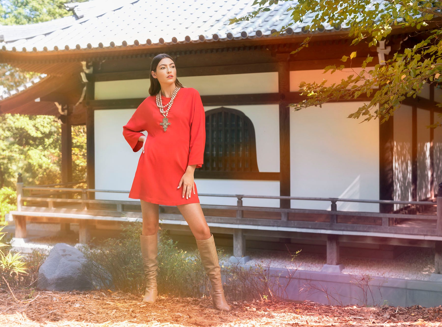 Red Dress: A.L.C., Twill Knee High Boots: Marc Fisher Ltd., Muse Statement Necklace: Shanlu, Monkees of the West End Stylist: Ann Ricker Hair and makeup: Sophie Wilson Model: Haylee Location: Special thanks to Furman University for the use of Roe Art Building, The Place of Peace and the Asia Garden.