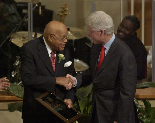 Fred Garrett, Sr., shakes hands with former U.S. President Bill Clinton in 2007 after he receiving a Presidential Citation at the South Carolina State Conference 29th Annual Freedom Fund Celebration at Bible Way Church of Atlas Road in Columbia.