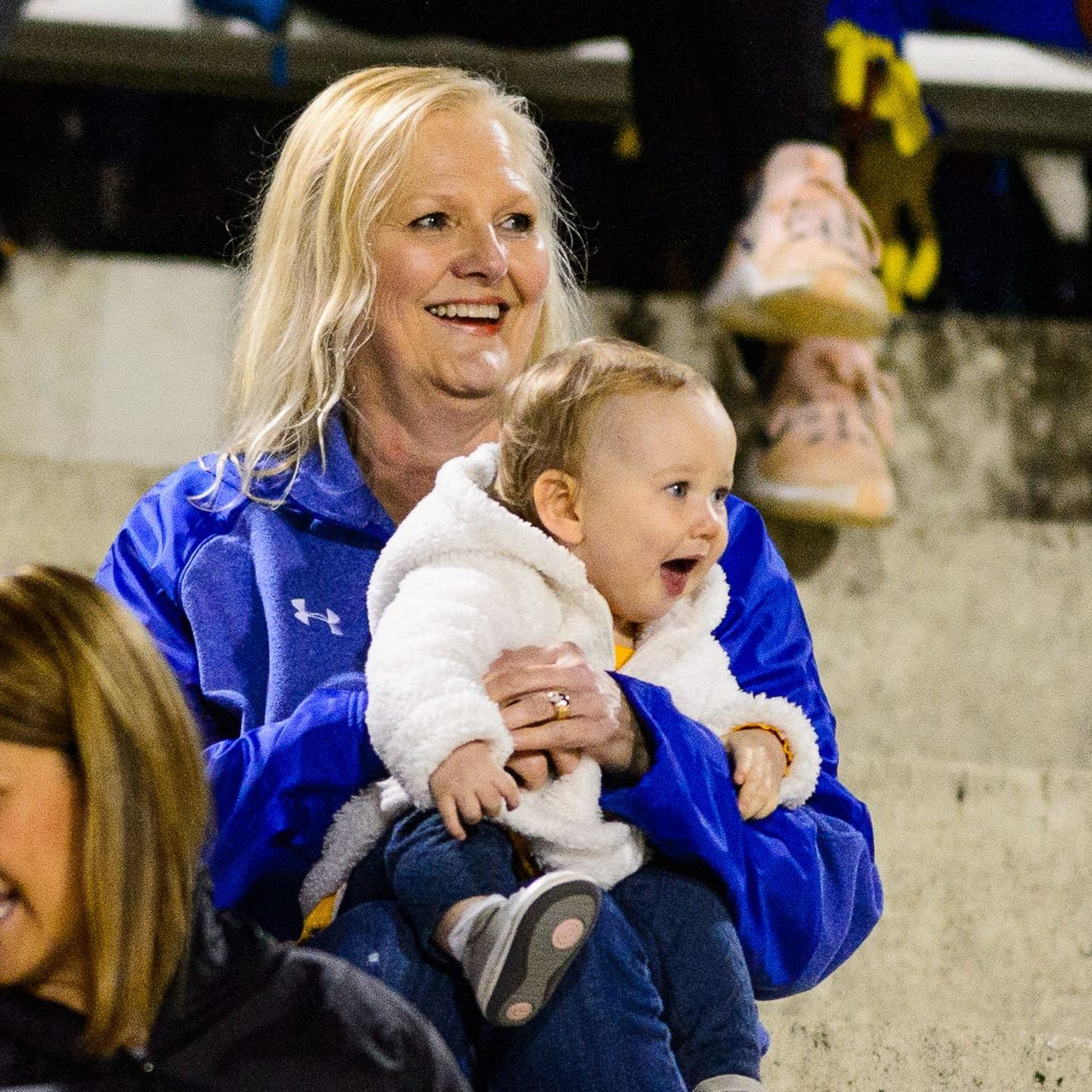 Lynn Tate, wife of Wren High School football coach Jeff Tate, enjoys the experience as she watches Wren's Class AAAA first-round playoff game against Greenville with their granddaughter, Sawyer.