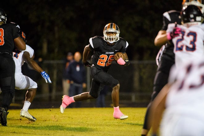 Senior running back Trayy Oglesby (25) and the Southside Tigers will play at Pendleton Friday in the second round of the Class AAA playoffs.