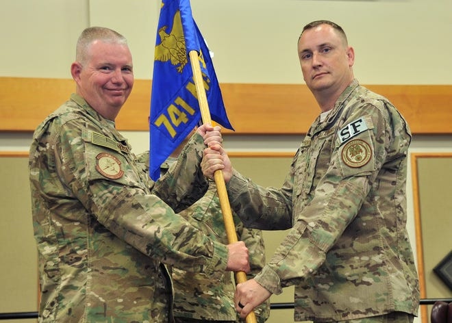 Lt. Col. Raymond Fortner, right, accepts command of the 741st Missile Security Forces Squadron from Col. Robert Frederiksen, 341st Security Forces Group commander July 12, 2017 at Malmstrom Air Force Base. Fortner was relieved of duty on Tuesday