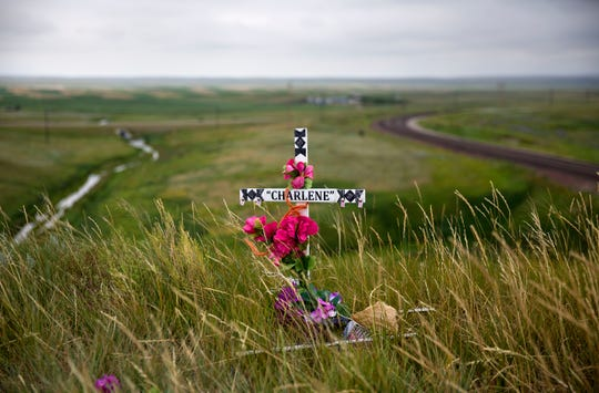 FILE--In this July 14, 2018, file photo, a makeshift memorial stands near the scene where Charlene Mancha was murdered by her husband last year on the Blackfeet Indian Reservation in Browning, Mont. A study released by a Native American non-profit says numerous police departments in cities nationwide are not adequately identifying or reporting cases of missing and murdered indigenous women. (AP Photo/David Goldman, file)