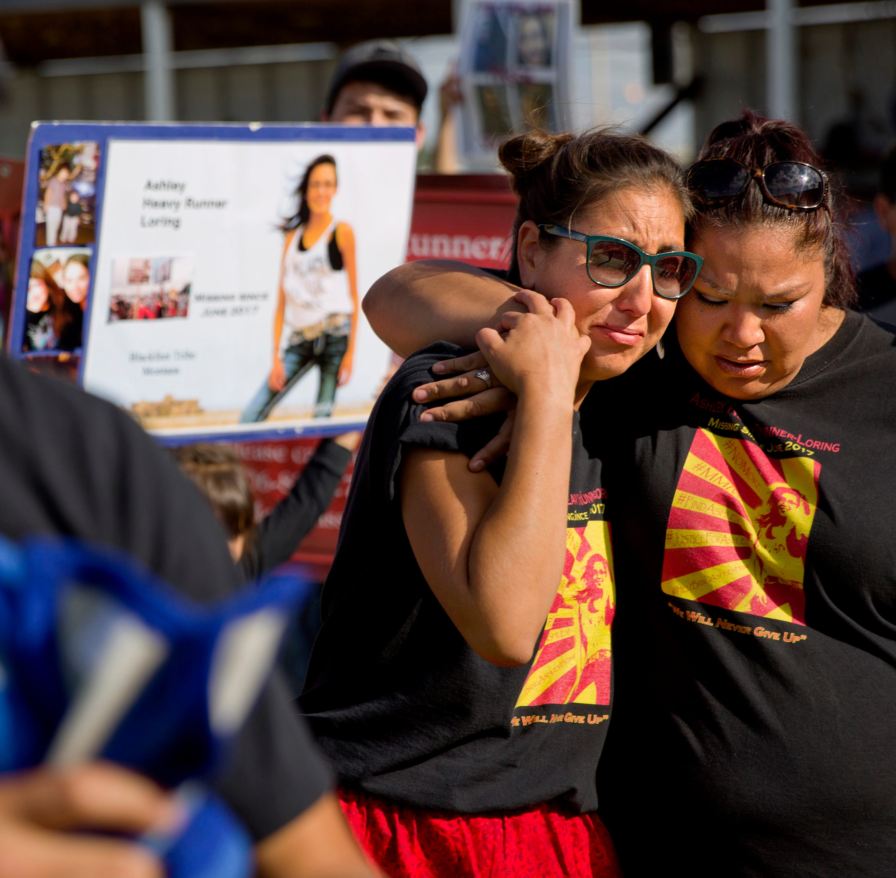 FILE - In this July 14, 2018 file photo, Jenna Loring, left, the aunt of Ashley HeavyRunner Loring, cries with her cousin, Lissa Loring, during a traditional blanket dance before the crowd at the North American Indian Days celebration on the Blackfeet Indian Reservation in Browning, Mont. A study released by a Native American non-profit says numerous police departments in cities nationwide are not adequately identifying or reporting cases of missing and murdered indigenous women. (AP Photo/David Goldman, File)