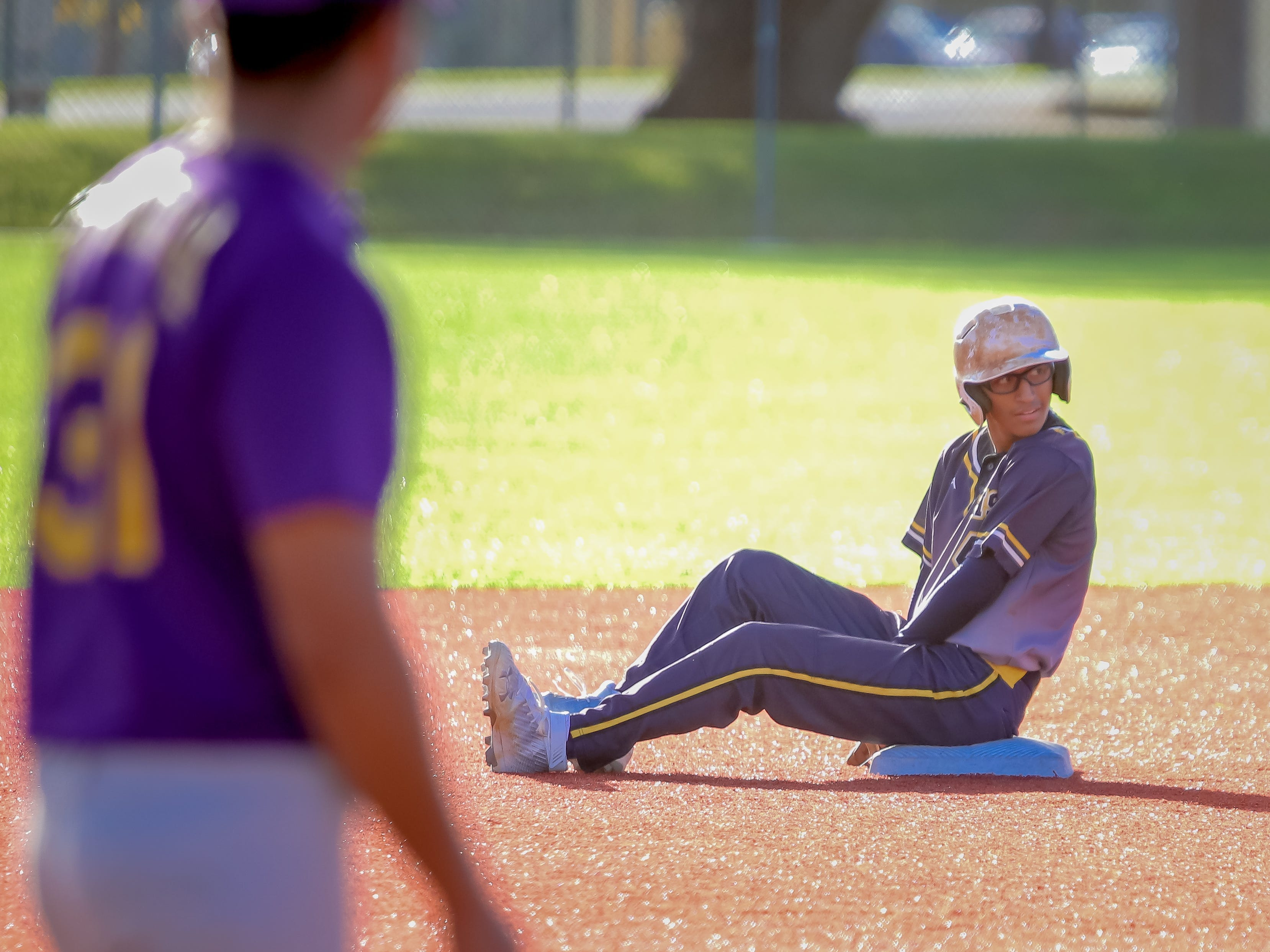 Ruben Ramirez of Guam High sits on second base after an attempt to steal.