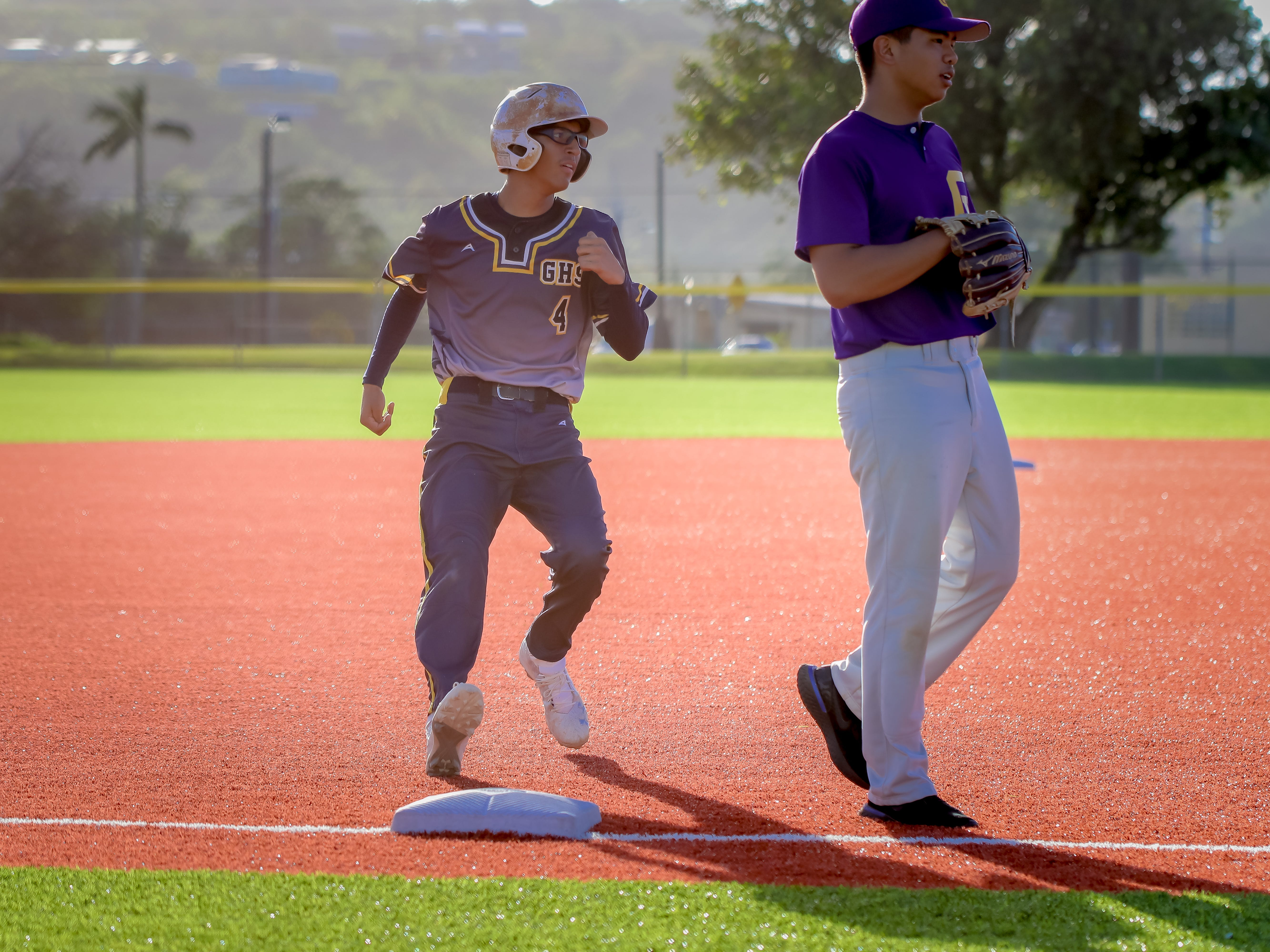 Ruben Ramirez of Guam High steals third base.