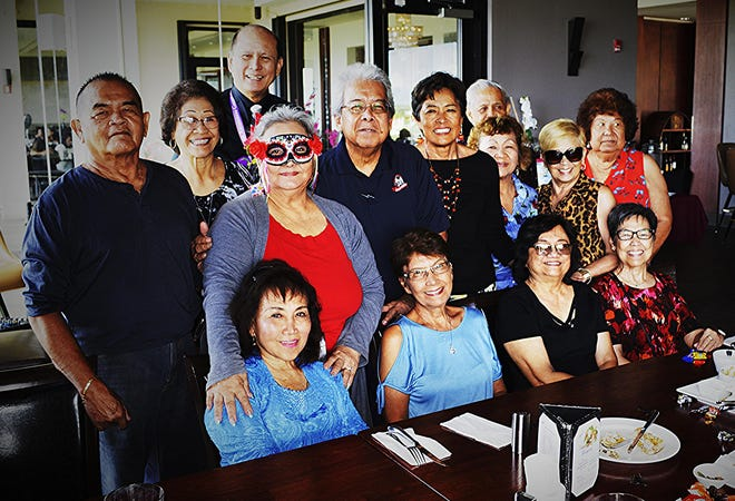 The Guam High School Class of 1965 had a halloween luncheon at Papa's Restaurant on Airport Road on Oct. 31. Some members wore Halloween masks and seasonal pumpkins and bats and wished Bon Voyage to one of our classmates, Helen Aguon. Seated from left: Natividad Gumataotao, Lila Gombar, Terry Hagen, Annie Auyong. Standing from left: Jesus Guerrero, Sera Taitano, Maryann Cabrera, John Taitano, Victor Perez, Doris Brooks, Alfred Cabrera, Helen Aguon, Annie Duenas and Flo Aguon.
