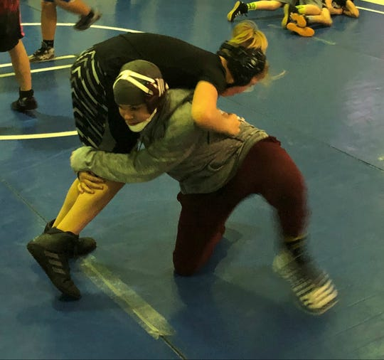 J.J. Poynter, right, takes down Jaxson Wallace during Henderson County's wrestling practice Tuesday at Central Learning Academy. Henderson County is fielding a wrestling program for the first time in several years.