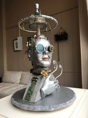 """""""Head Case - Flash"""" by Connie McConaughy is part of the OVAL Steampunk'd exhibit."""