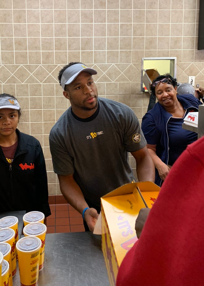 Colts' running back Nyheim Hines works the lunch-hour rush at the Bojangles on NC State's campus