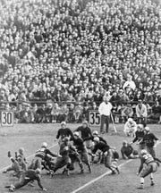 A crowd of 80,000 watched Notre Dame running back Nicholas Lukats run for 4 yards against Army in the first half of their 1932 game at Yankee Stadium in New York. The Army-Notre Dame rivalry was one of the best of the 20th century. (AP Photo/File)